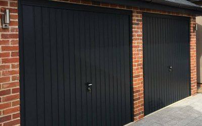 Retractable steel framed garage doors